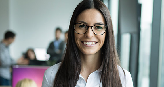 Smiling woman in glasses with beautiful teeth