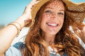 Smiling woman wearing a sunhat